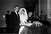 05/07/1967<br /> 07/05/1967<br /> 05 July 1967<br /> Wedding of George Walsh, eldest son of Mr and Ms Kevin G. Walsh, St. Rita's, Firhouse Road, Templeogue, Co. Dublin and Miss Arlene McMahon, elder daughter of Det. Chief Supt. Philip McMahon, Head of Special Branch, Dublin Castle and Mrs McMahon of Lisieux, Templeville Park, Templeogue, Co. Dublin who were married at the Carmelite Church, Terenure College, Dublin. An Taoiseach Mr Jack Lynch and Mrs Lynch; Mr Liam Cosgrove, leader Fine Gael and Mrs Cosgrave were among the 120 guests. Rev Fr H.E. Wright, O. Carm., Moate, officiated at the ceremony. The reception was held at Downshire Hotel, Blessington, Co. Wicklow. Signing the register.