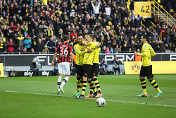 "15.02.2014, Signal Iduna Park, Dortmund, GER, 1. FBL, Borussia Dortmund vs Eintracht Frankfurt, 21. Runde, im Bild Pierre-Emerick Aubameyang (Borussia Dortmund #17), Nuri Sahin (Borussia Dortmund #18), Henrikh ""Micki"" Mkhihtaryan (Borussia Dortmund #10) feiern den Torschuetzen zum m3:0 Robert Lewandowski (Borussia Dortmund #9) mit Marc-Oliver Kempf (Eintracht Frankfurt #36) enttaeuscht, Torjubel, Emotion, Freude, Glueck, Positiv // during the German Bundesliga 21th round match between Borussia Dortmund and Eintracht Frankfurt at the Signal Iduna Park in Dortmund, Germany on 2014/02/15. EXPA Pictures © 2014, PhotoCredit: EXPA/ Eibner-Pressefoto/ Schueler<br /> <br /> *****ATTENTION - OUT of GER*****"