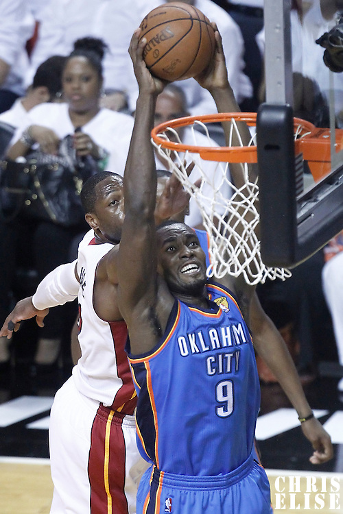 21 June 2012: Oklahoma City Thunder power forward Serge Ibaka (9) dunks the ball during the Miami Heat 121-106 victory over the Oklahoma City Thunder, in Game 5 of the 2012 NBA Finals, at the AmericanAirlinesArena, Miami, Florida, USA. The Miami Heat wins the series 4-1.