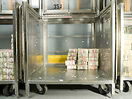 Bundles of U.S. five dollar bills stacked in a rolling container called a truck, at the U.S. Federal Reserve Bank of Chicago.