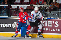 KELOWNA, CANADA - FEBRUARY 5: Ethan McIndoe #10 of Spokane Chiefs checks Lucas Johansen #7 of Kelowna Rockets on February 5, 2016 at Prospera Place in Kelowna, British Columbia, Canada.  (Photo by Marissa Baecker/Shoot the Breeze)  *** Local Caption *** Ethan McIndoe; Lucas Johansen;