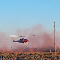 A federal fire management official credited air support, which included two helicopters, for stopping a wildland fire near Sawmill, Arizona, from increasing in size Sunday.