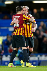 Christopher Routis and Andrew Davies of Bradford City celebrate after Bradford City pull of a remarkable comeback from 2-0 down to win the match 2-4 and progress to the fifth round of the FA Cup - Photo mandatory by-line: Rogan Thomson/JMP - 07966 386802 - 24/01/2015 - SPORT - FOOTBALL - London, England - Stamford Bridge - Chelsea v Bradford City - FA Cup Fourth Round Proper.