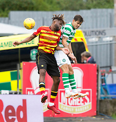 Partick Thistle's Andrea Mbuyi-Mutombo (left) Celtic's Michael Johnston (right) during the Betfed Cup Second Round match at the Energy Check Stadium at Firhill, Glasgow.