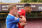 York City forward Vadaine Oliver battles with Carlisle United defender Tom Miller during the Sky Bet League 2 match between York City and Carlisle United at Bootham Crescent, York, England on 19 September 2015. Photo by Simon Davies.