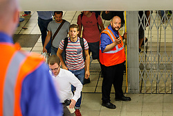 © Licensed to London News Pictures. 05/08/2015. London, UK. Tube workers closing the gates at Victoria station during the Tube strike in the evening rush hour of Wednesday, August 5, 2015. The strike will be a 27-hour stoppage by about 20,000 Tube staff to shut down the entire London Underground network on the second strike over night `service on parts of Tube, which will be starting on 12 September 2015. Photo credit: Tolga Akmen/LNP