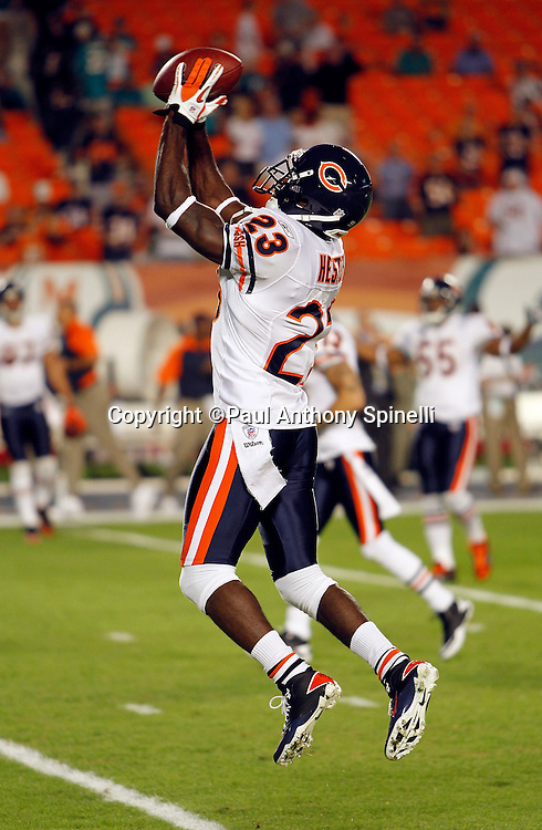 Chicago Bears wide receiver Devin Hester (23) leaps and catches a pregame pass during the NFL week 11 football game against the Miami Dolphins on Thursday, November 18, 2010 in Miami Gardens, Florida. The Bears won the game 16-0. (©Paul Anthony Spinelli)