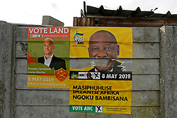 Wednesday 8th May 2019.<br /> Monwabisi Park, Harare,<br /> Khayelitsha, Cape Town, <br /> Western Cape, <br /> South Africa.<br /> <br /> SOUTH AFRICAN GENERAL ELECTIONS 2019!<br /> <br /> SOUTH AFRICAN PROVINCIAL AND NATIONAL ELECTIONS 2019! <br /> <br /> A torn ANC elections poster is seen with another political party poster on a wall outside the voting station at Monwabisi Park, Harare in Khayelitsha near Cape Town, Western Cape, South Africa.<br /> <br /> Registered South African Voters head to the various IEC (Independent Electoral Commission) Voting Stations where they are registered to vote as they cast their votes and take part in voting and other activities on Voting Day 8th May 2019 during the South African General Elections 2019. Voters from across the nation stood in queue's along with many others to vote in the Provincial and National Elections being held in South Africa on Wednesday 8th May 2019.   <br />  <br /> Copyright © Mark Wessels. All Rights Reserved. No Usage Without Permission.<br /> <br /> PICTURE: MARK WESSELS. 08/05/2019.<br /> +27 (0)61 547 2729.<br /> mark@sevenbang.com<br /> studioseven@mweb.co.za<br /> www.markwesselsphoto.com
