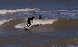 Surfing the waves in De Haan, Belgium, Sunday, Sept. 14, 2008. (Photo © Jock Fistick)