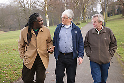 Group of men walking in a park and chatting. Cleared for Mental Health issues.