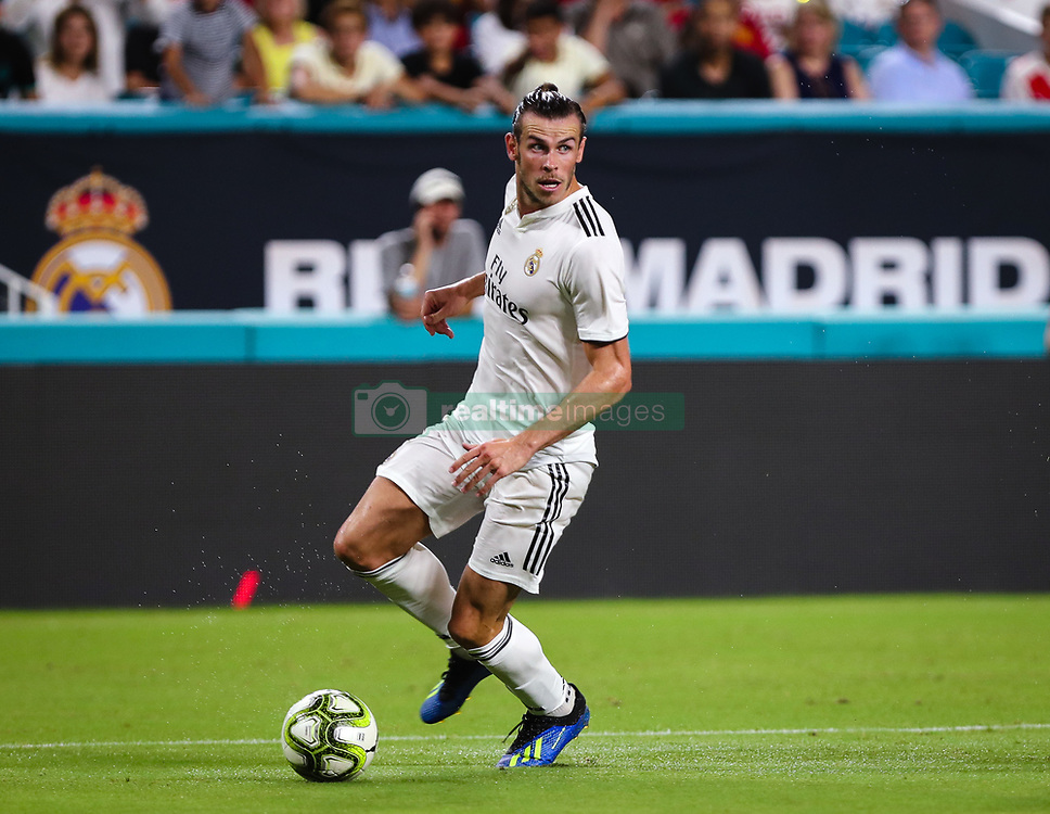 July 31, 2018 - Miami Gardens, Florida, USA - Real Madrid C.F. forward Gareth Bale (11) drives the ball during an International Champions Cup match between Real Madrid C.F. and Manchester United F.C. at the Hard Rock Stadium in Miami Gardens, Florida. Manchester United F.C. won the game 2-1. (Credit Image: © Mario Houben via ZUMA Wire)