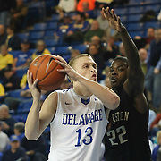 Delaware Guard Kyle Anderson (13) drives to the hoop as College of Charleston Guard Anthony Stitt (22) defends in the first half of a NCAA regular season Colonial Athletic Association conference game between Delaware and The College of Charleston Wednesday, Feb 5, 2014 at The Bob Carpenter Sports Convocation Center in Newark Delaware.