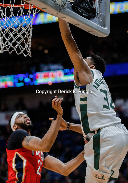 Dec 13, 2017; New Orleans, LA, USA; Milwaukee Bucks forward Giannis Antetokounmpo (34) dunks over New Orleans Pelicans forward Anthony Davis (23) during the first quarter at the Smoothie King Center. Mandatory Credit: Derick E. Hingle-USA TODAY Sports