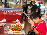 06 AUGUST 2014 - BANGKOK, THAILAND: People pray at the Poh Teck Tung foundation temple and shrine in the Chinatown section of Bangkok. Poh Teck Tung is a Chinese religious NGO that provides educational and health services and an emergency medical system in Bangkok. Every year, during Hungry Ghost Month, the foundation gives away food and staples to the poor of Bangkok.      PHOTO BY JACK KURTZ