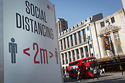 Social Distance advice has been placed at regular intervals along Oxford Street such as opposite the Dominion theatre on Tottenham Court Road, on the day that UK Prime Minster, Boris Johnson announced in parliament a major easing of Coronavirus pandemic restrictions on July 4th next week, including the re-opening of pubs, restaurants, hotels and hairdressers in England, on 23rd June 2020, in London, England. The three month two metre social distance will be also reduced to one metre plus but in the last 24hrs, a further 171 have died from Covid, bringing the UK total to 42,927.