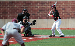 26 April 2014:  Paul DeJong bats in front of catcher Matt Jones and umpire Bret Bruington during an NCAA Division 1 Missouri Valley Conference (MVC) Baseball game between the Southern Illinois Salukis and the Illinois State Redbirds in Duffy Bass Field, Normal IL