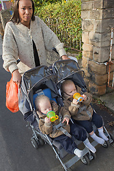 Mother pushing twins in buggy. (This photo has extra clearance covering Homelessness, Mental Health Issues, Bullying, Education and Exclusion, as well as the usual clearance for Fostering & Adoption and general Social Services contexts,)