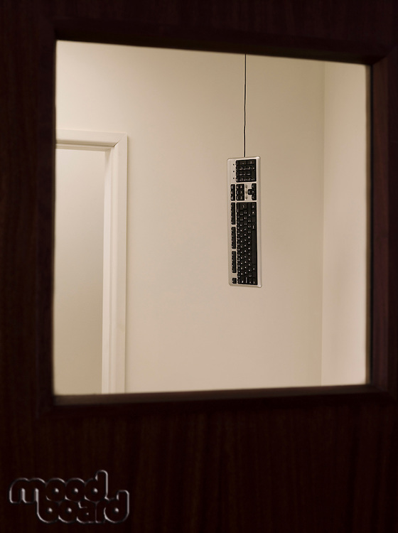 Keyboard hanging from ceiling