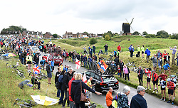 Riders climb Brill Hill with Brill Windmill in the background during stage seven of the OVO Energy Tour of Britain from Hemel Hempstead to Cheltenham.