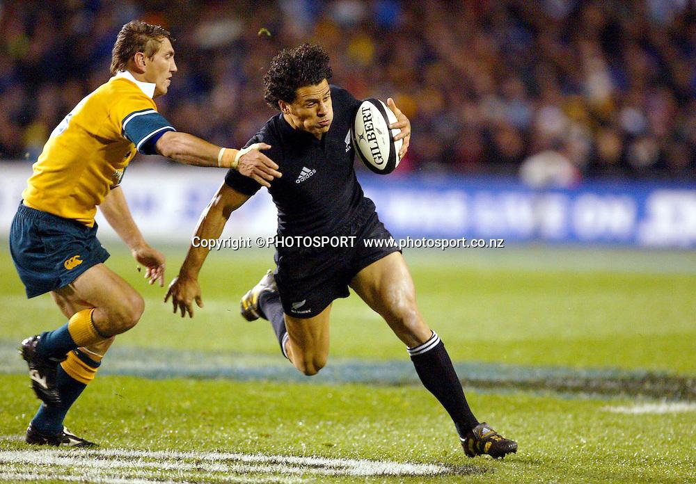 16th August, 2003. Eden Park, Auckland, New Zealand. Bledisloe Cup Match. New Zealand v Australia.<br />Doug Howlett.<br />The All Blacks won the match, 21 - 17.<br />Pic: Andrew Cornaga/Photosport
