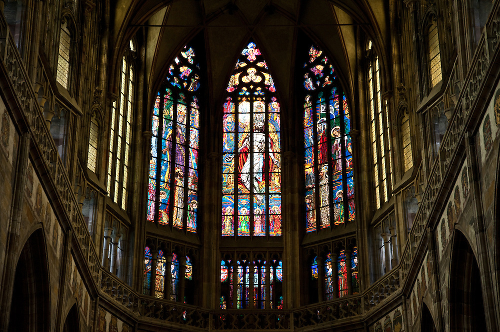 Prague, Czech Republic:  Resurrection of Jesus, with God the Father, depicted in the stained glass windows above the altar, St. Vitus Cathedral (Katedrala Sv. Vita) within the Castle Square complex.