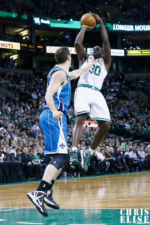 16 January 2013: Boston Celtics power forward Brandon Bass (30) takes a jumpshot over New Orleans Hornets power forward Jason Smith (14) during the New Orleans Hornets 90-78 victory over the Boston Celtics at the TD Garden, Boston, Massachusetts, USA.