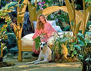 Bobbie Leonard, Interior Designer, Portrait, woman sitting on Palm Leafed Bed, Outdoor,  Great Dane, Awesome