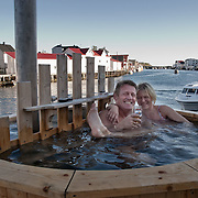 Three weeks aboard the Kong Harald. Hurtigruten, the Coastal Express. Svolvaer in the Lofotens. People having a bubble bath in Svolvaer.