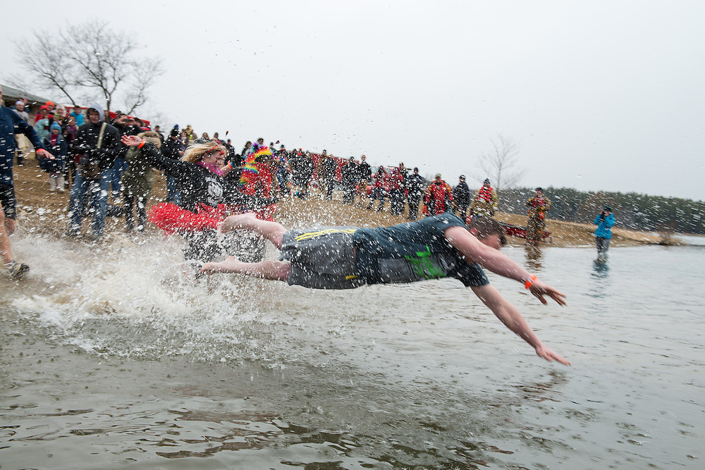 Participants dive into the freezing water of Lake Snowdon to raise money for the Special Olympics at the annual Polar Plunge.