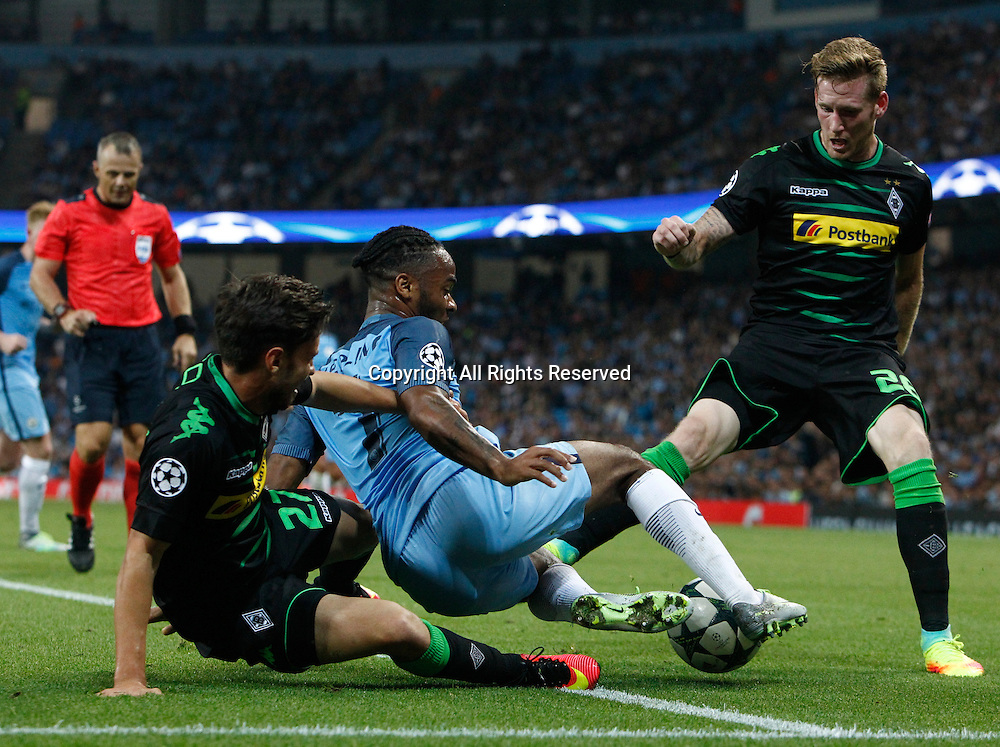 14.09.2016. The Etihad, Manchester, England. UEFA Champions League Football. Manchester City versus Borussia Monchengladbach.  Manchester City striker Raheem Sterling (7) retains possession in the penalty area as Borussia Mönchengladbach midfielder Tsiy William Ndenge and Julian Korb challenge.