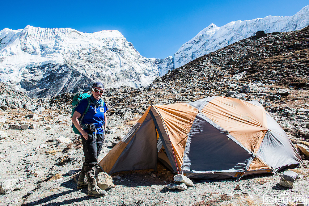 Katie standing next to his Mountain Hardwear tent at Island Peak Base Camp, which is at 4970 metres and on the side of the Lhotse Shar Glacier and Imja Tsho (lake).