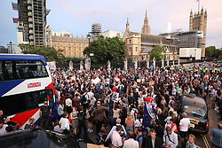 © Licensed to London News Pictures. 28/08/2019. London, UK. Anti Brexit Protestors gather outside Parliament. Earlier it emerged that The Queen will be asked by the government to suspend Parliament in the days after MPs return to work in September - a few weeks before the Brexit deadline of October 31st. Photo credit: Peter Macdiarmid/LNP