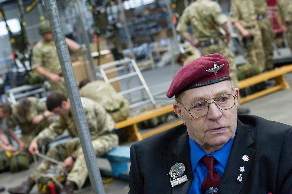 Geoff Patinson, 90,  9 Para.with the men of 16 AIr Assault Brigade as they train for the d-day drop in a mock plane. Veterans of the Parachute Regiment at the time of D Day, in the second world war, visit 16 Air Assault Brigade who will be carrying out a drop to commemorate the 70th anniversary next week. Colchester, UK.