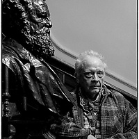 &copy; Licensed to London News Pictures. 21_02_2013<br /> Bailey's East End Faces .<br /> Photographer David Bailey with a statue of William Morris, at the William Morris Gallery, where his latest exhibition of Photographs taken around London's  East End, during the sixties. The exhibition is on at the William Morris Gallery in Walthamstow, East London until the end of May. Photo credit : Andrew Baker/LNP