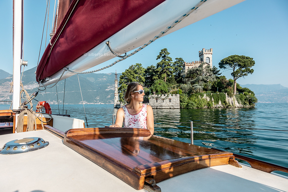 iTALY, ISEO LAKE, sailing with a traditional wooden sailing boat, Isola di Loreto