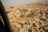 December 2006, Baghdad, Iraq --- Black Hawk over Baghdad --- Image by © Owen Franken/Corbis
