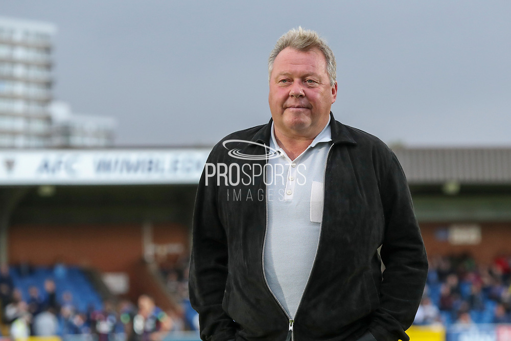 AFC Wimbledon manager Wally Downes in front of AFC Wimbledon sign during the Pre-Season Friendly match between AFC Wimbledon and Crystal Palace at the Cherry Red Records Stadium, Kingston, England on 30 July 2019.