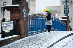 © Licensed to London News Pictures. 01/02/2019. London, UK. A woman with a bright coloured umbrella navigates treacherous walking conditions in Little Venice in West London as large parts of the UK are deluged with snow and freeing temperatures. Photo credit: Ben Cawthra/LNP