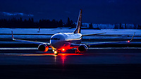 An Air North Boeing 737-500 prepares to taxi for a morning departure to Vancouver.