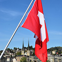 Rectangular Swiss Flag Flying Over Lake Lucerne in Lucerne, Switzerland<br />