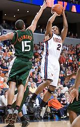 Virginia Cavaliers guard J.R. Reynolds (2) shoots over Miami Hurricanes guard Denis Clemente (15).  The University of Virginia Cavaliers defeated the Miami Hurricanes Men's Basketball Team 81-70 at the John Paul Jones Arena in Charlottesville, VA on February 3, 2007.