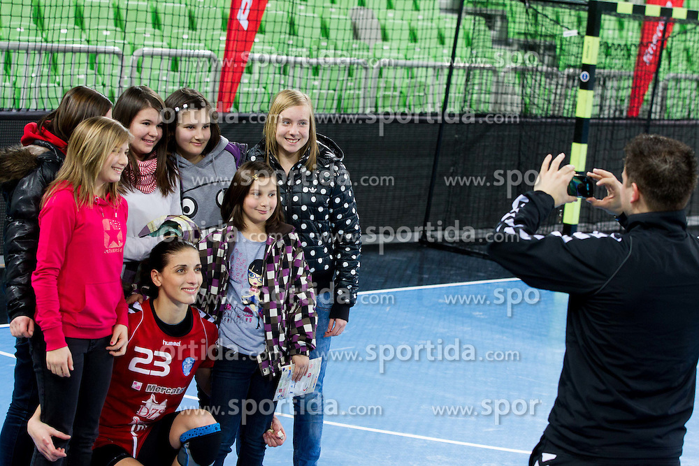 Andrea Penezic of Krim Mercator with fans after the handball match between RK Krim Mercator and Buducnost Podgorica (MNE) in season 2011/2012 of EHF Women's Champions League, on February 24, 2012 in Arena Stozice, Ljubljana, Slovenia. Buducnost defeated Krim 27-26. (Photo By Vid Ponikvar / Sportida.com)