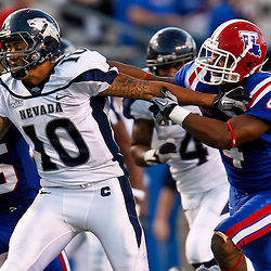 December 4, 2010; Ruston, LA, USA;  Nevada Wolf Pack quarterback Colin Kaepernick (10) runs from Louisiana Tech Bulldogs safety Tank Calais (4) during the second half at Joe Aillet Stadium.  Nevada defeated Louisiana Tech 35-17. Mandatory Credit: Derick E. Hingle