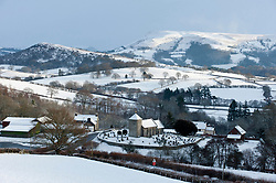 © Licensed to London News Pictures. 09/12/2017. Llanddewi'r Cwm, Powys, Wales, UK. Saint David's Church in the small village of Llanddewi'r Cwm in Powys, Wales, UK is surrounded by a winter landscape after another snowfall last night. Photo credit: Graham M. Lawrence/LNP