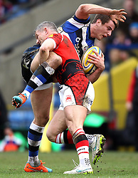 London Welsh's Tom May tackles Bath's Kyle Eastmond - Photo mandatory by-line: Robbie Stephenson/JMP - Mobile: 07966 386802 - 29/03/2015 - SPORT - Rugby - Oxford - Kassam Stadium - London Welsh v Bath Rugby - Aviva Premiership
