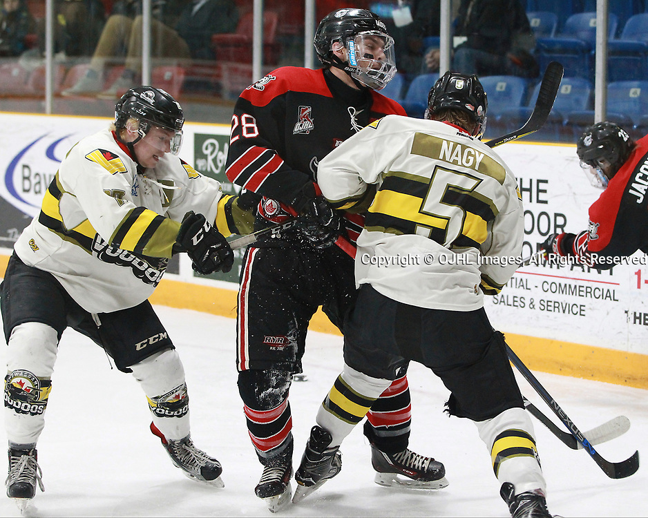 TRENTON, ON  - MAY 5,  2017: Canadian Junior Hockey League, Central Canadian Jr. &quot;A&quot; Championship. The Dudley Hewitt Cup. Game 7 between Georgetown Raiders and the Powassan Voodoos. Josh Dickinson #28 of the Georgetown Raiders and  Eric Nagy #5 of the Powassan Voodoos battle for position during the first period.<br /> (Photo by Tim Bates / OJHL Images)