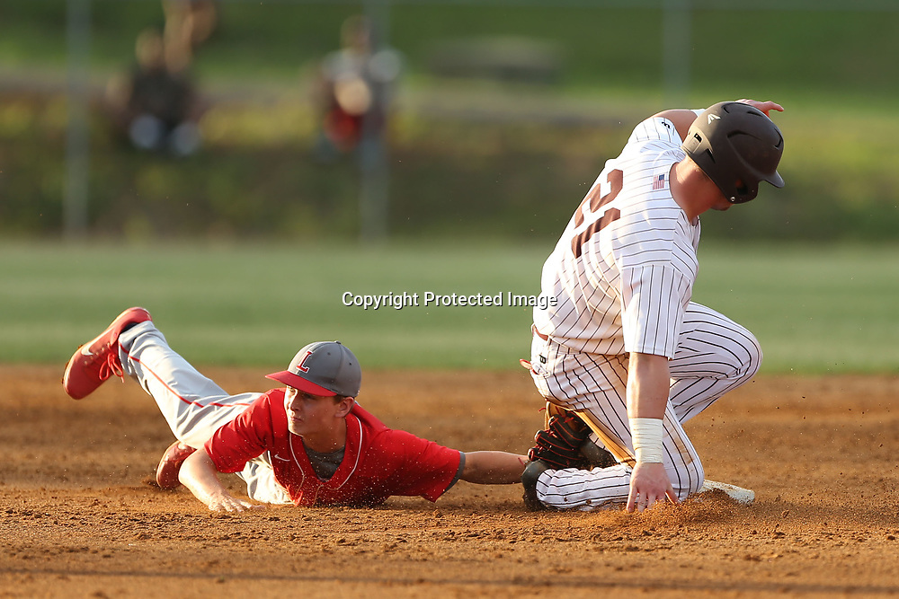 Houston's Tanner Bullock makes slides safely into second base as Lafayette shortstop reaches for the out.