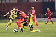Dagenham & Redbridge defender Nyron Nosworthy  tackles York City forward Vadaine Oliver during the Sky Bet League 2 match between York City and Dagenham and Redbridge at Bootham Crescent, York, England on 20 October 2015. Photo by Simon Davies.