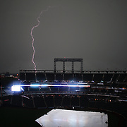 NEW YORK, NEW YORK - July 25: Strike one...A lightning  bolt over Citi Field as stormy weather delayed the start of the St. Louis Cardinals Vs New York Mets regular season MLB game at Citi Field on July 25, 2016 in New York City. (Photo by Tim Clayton/Corbis via Getty Images)