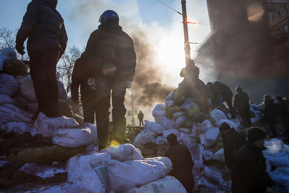 KIEV, UKRAINE - JANUARY 24: Anti-government protesters stand atop barricades near Dynamo stadium on January 24, 2014 in Kiev, Ukraine. After two months of primarily peaceful anti-government protests in the city center, new laws meant to end the protest movement have sparked violent clashes in recent days. (Photo by Brendan Hoffman/Getty Images) *** Local Caption ***